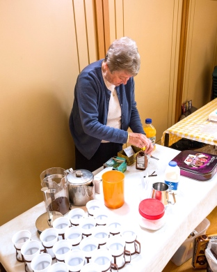 Volunteer serving tea in church